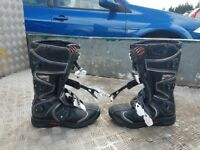 Motorcycle boots, helmet, and body armour