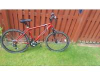 Red hardly used bike in great condition