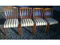 Four beautiful upholstered dining chairs