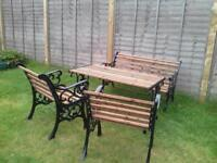 table chairs and bench set very heavy cast iron set