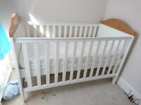 White cot bed with mattress and waterproof cover