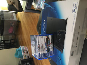 500gb PS4 with 2 controllers and 9 games