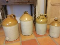 An opportunity to purchase a beautiful collection of antique stoneware flagons.
