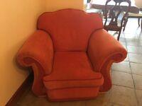 x2 orange one seater sofas - good condition - super comfy!