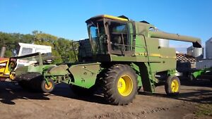 JD 7720 SP combine with 212 Pickup