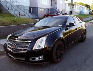 2008 black on back Cadillac custom leather seats CTS