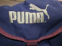 Puma Rucksack Navy and Red with side Pockets and front zipped Pocket