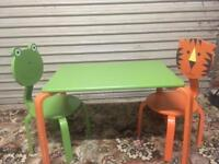 Children's table and two chairs.