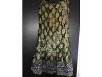 Ladies green skirt suit