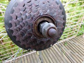 """Bike wheel, rear, 26"""", spares or repair, buckled."""