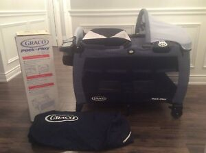 Blue Graco Pack n Play Portable playard with bassinet