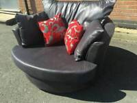 Very nice BRAND NEW swivel cuddle love chair .can deliver