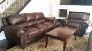 100% Genuine Leather 2 Sofas and a Chair.