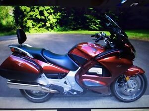 Honda st 1300.  Or trade for older gold wing  1998 and up