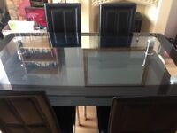 Glass and chrome table with 4 chairs