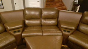 Sectional Recliner couch with cup holders and ottoman.