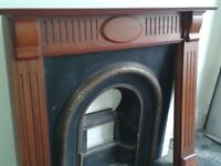 Victorian style cast iron fire place with wooden surround