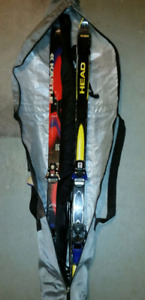 Two pair, men's skis.. Old school with bag.