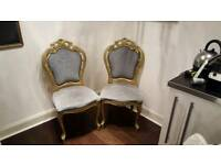 Two decorative dining chairs