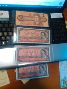 1954 2$ bill and 1986 2$  bill