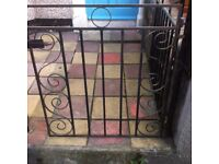 Gate. Black wrought iron garden gate. 81 by 92 inches.