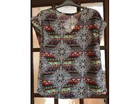 Bundle of patterned tops/shirts to fit size 6-8