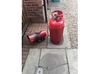 Red devil gas heater and gas bottle