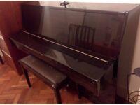 Upright piano for sale. Make 'Danor'. Includes piano stool.