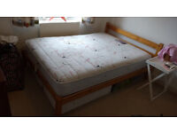 Wood framed double bed and memory foam topped mattress