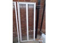Bifold white shower doors and matching side panel