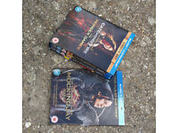 The hunger games, catching fire and mockingjay pt1, blu rays unused new never used or played