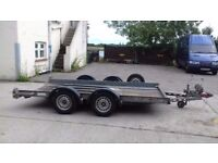 Twin axle Brian and James car transport trailer.