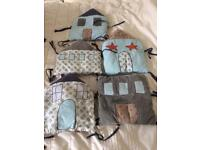 Set of cushioned cot bumper houses from La Redoute in good condition.