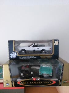 3 die cast cars - never opened