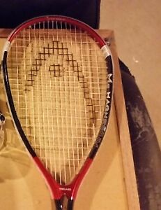 Head Magnesium 1100 Series Racquet with a ball