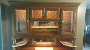 Two piece wood and glass cabinet