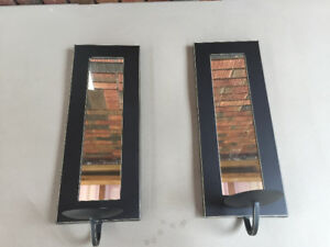Mirrored wall sconces with candle holders