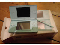 Nintendo DS Lite - Turquoise. Good condition boxed no power lead. 3 Games included