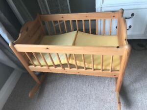 Wooden Rocking Craddle with foam cushion.