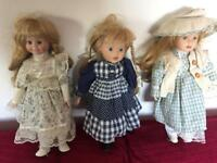 3 porcelain dolls 16 inches high