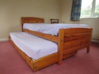 Twin single beds (folding trundle style) with mattresses. M&S wooden good condition.
