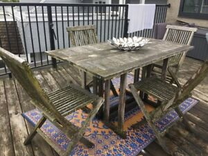 Teak outdoor dining table with 4 chairs