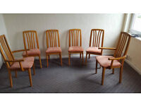 6 CHAIRS AND A LARGE ROUND TABLE