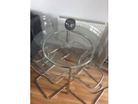 Ikea glass dining table and 4 dining chairs