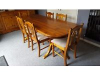 Solid wood (heavy so buyer collect only) dining table and six chairs. 7' long x 3' wide.