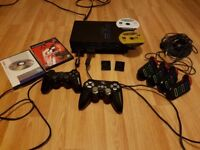 Playstation 2 with 2 Contollers + 2 Memory Sticks