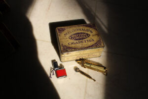 Cigarette Tin with old Brass Lighters