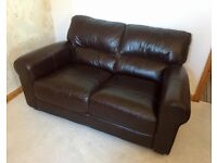 Brand new two-seater leather sofa