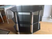 small black glass television stand.
