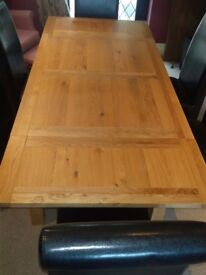 Brand new Oak dining table and 6 brown chairs